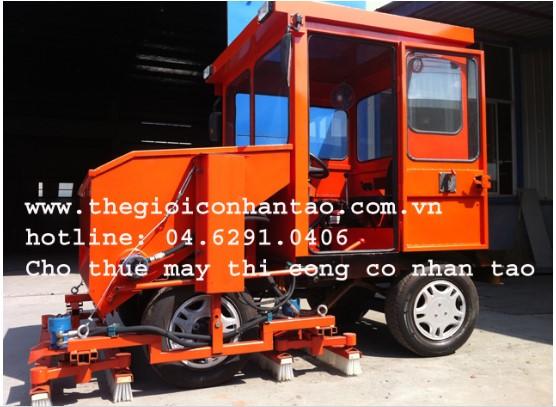 Máy thi công cỏ nhân tạo nhập khẩu 1